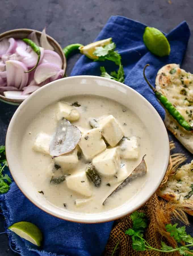 Paneer in white gravy served in a bowl.