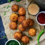 Make these super addictive Corn Cheese Balls for your next house party and see them disappear in seconds. These are easy to make, cheesy, crispy, freeze well and taste amazing. Here is how to make Corn Cheese Balls Recipe.