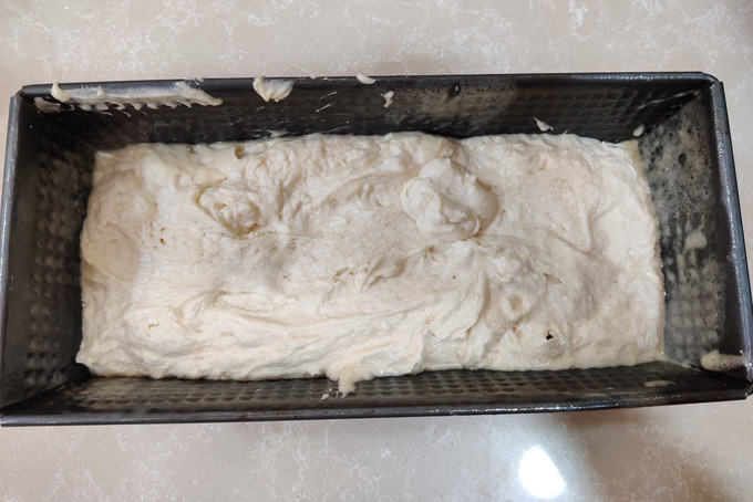 Remaining flour added and batter poured in the pan.
