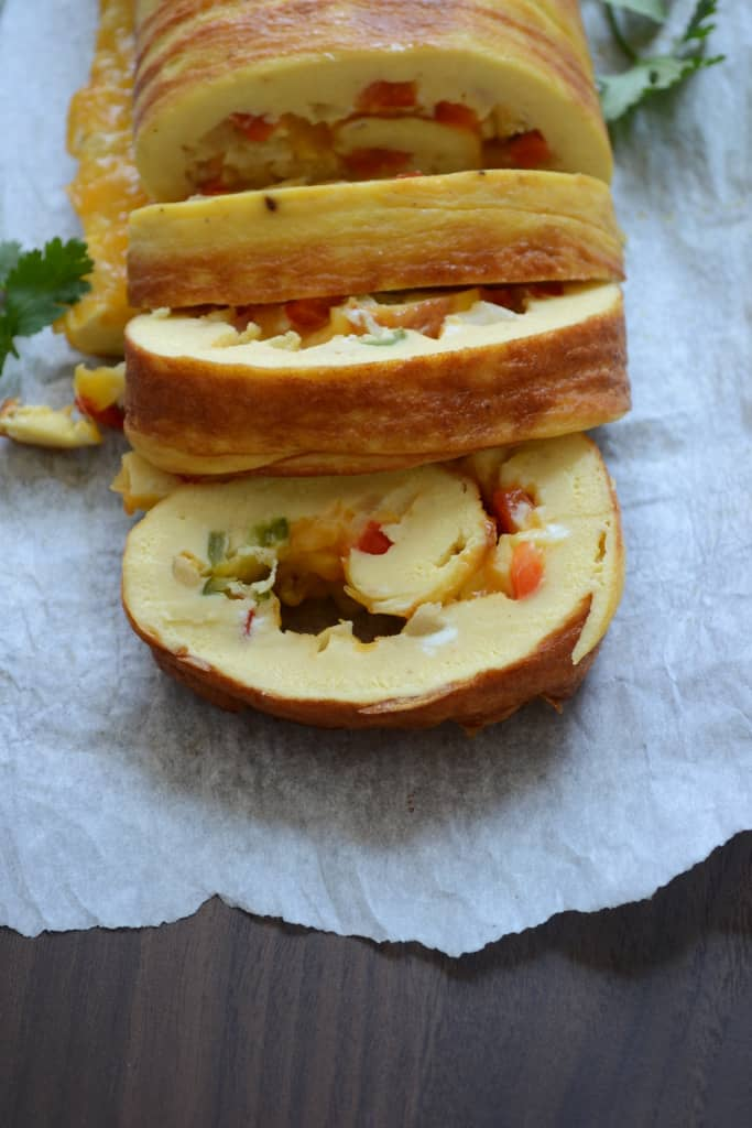 Cheesy egg roulade with red bell pepper and onion