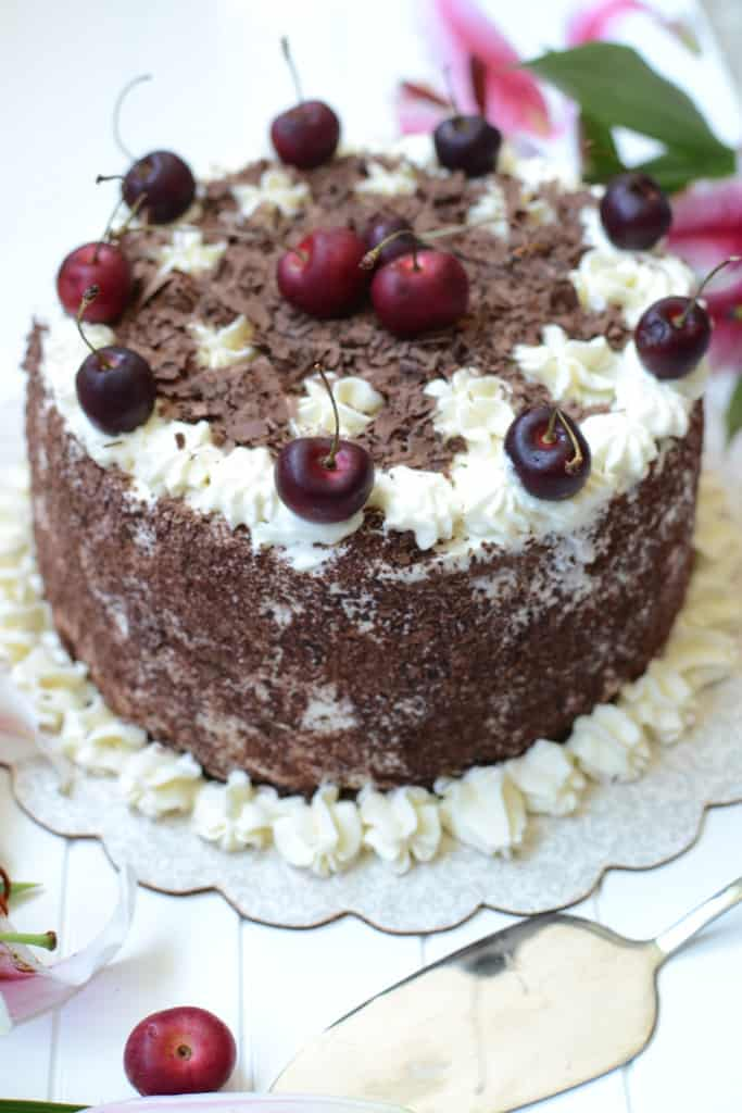 Black Forest Gateau is the English name for a German light as a feather dessert consisting several layers of chocolate cake, with whipped cream, cherry!