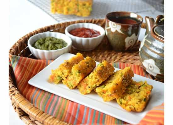 Savory Semolina Cake served with ketchup and mint chutney