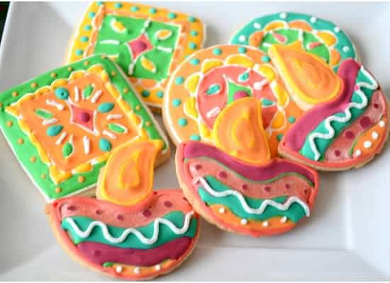Various Diwali shaped sugar cookies served on a plate