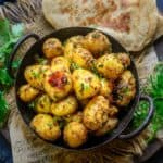 Masala Baby Potato Roast is a simple and quick to make recipe using baby potatoes and freshly ground masala that can perk up any meal. Here is how to make Masala Baby Potato Roast Recipe.