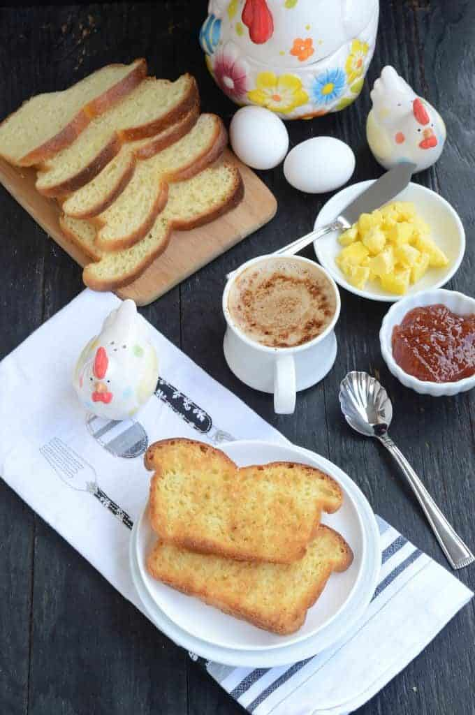 Bread served with butter, jam and coffee