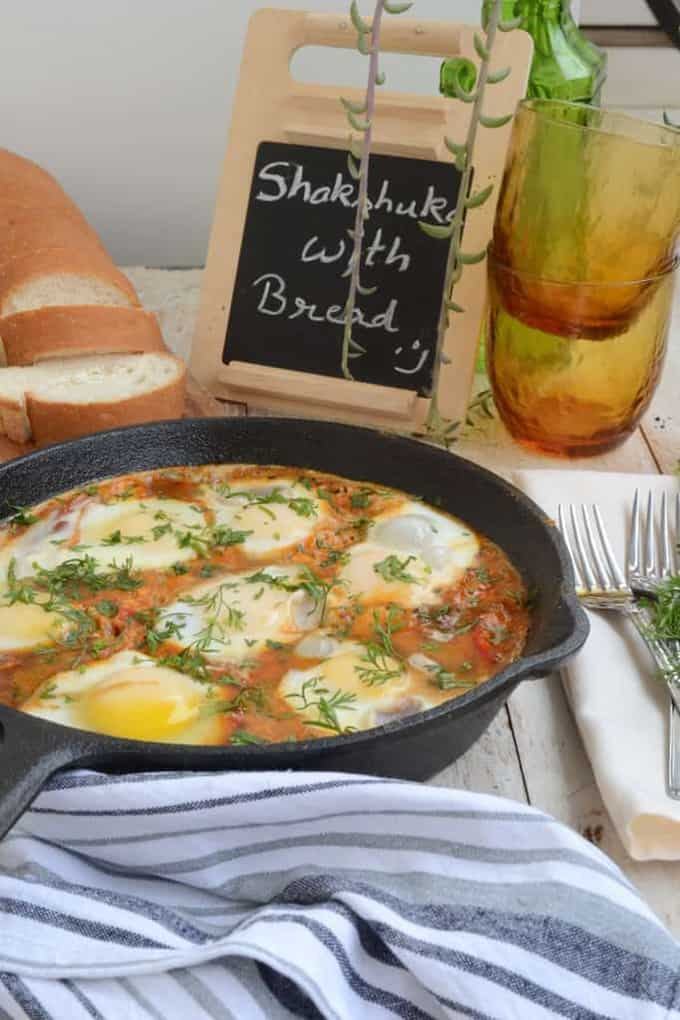 Shakshuka – Eggs poached in spicy tomato sauce.