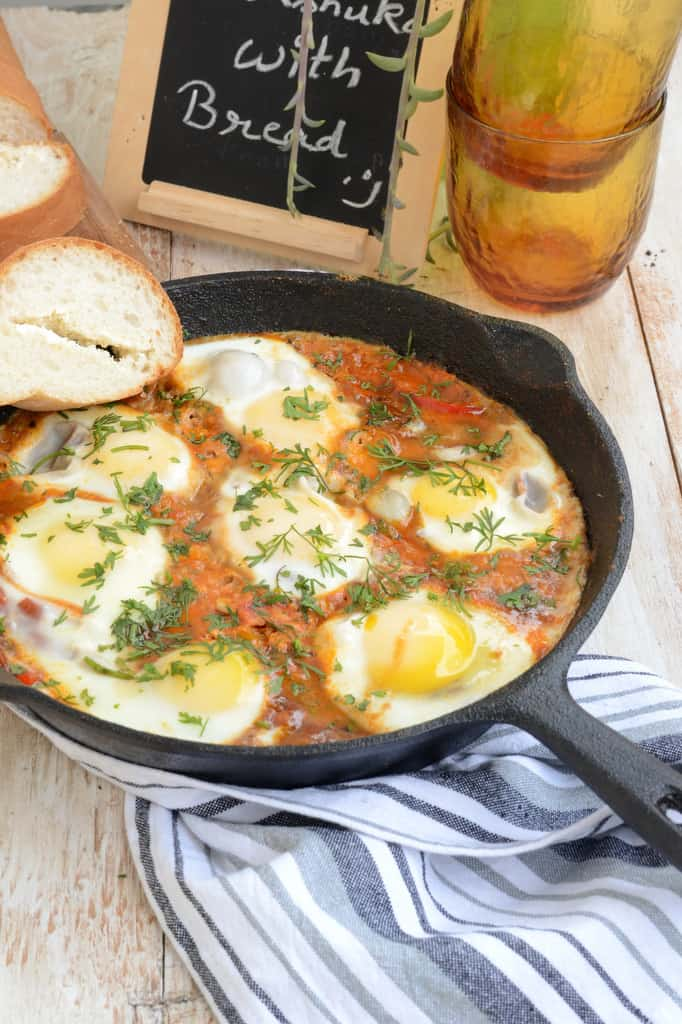 Shakshuka is a middle eastern dish where eggs are poached in a spicy tomato sauce. Perfect to have along with a side of bread.Here is how to make Shakshuka!