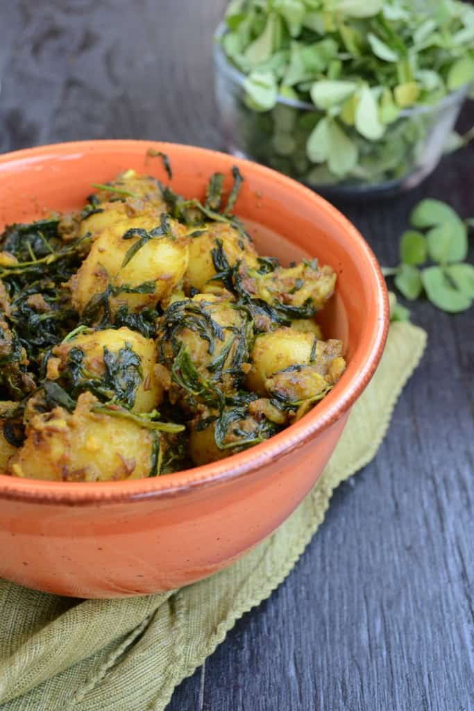 Methi Aloo is a very easy and simple preparation made in Indian households using fresh fenugreek leaves and baby potatoes.