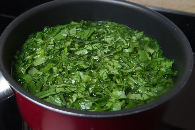 Spinach and methi in hot water.