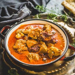 Rogan Josh  is a Kashmiri style Mutton (Lamb) Curry made with spices like fennel seeds and dry ginger.