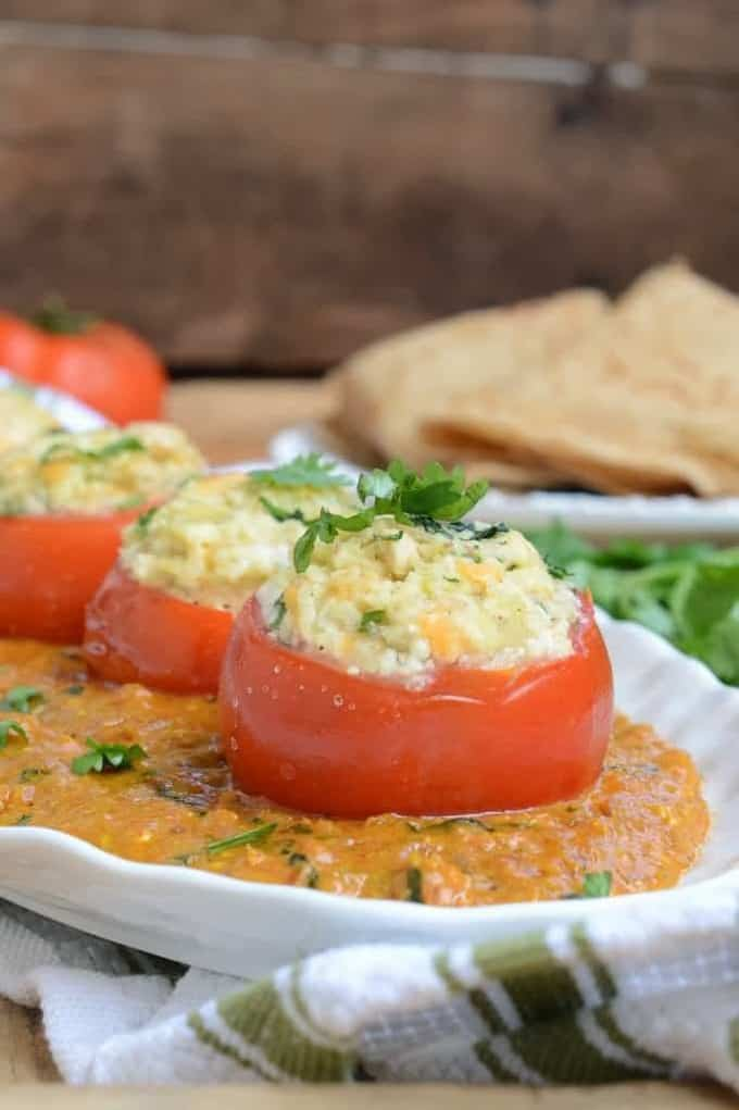 Stuffed Tomatoes in Malai Gravy is a delicious Indian curry where fresh tomatoes are stuffed with a rich paneer stuffing and then simmered in a creamy gravy.