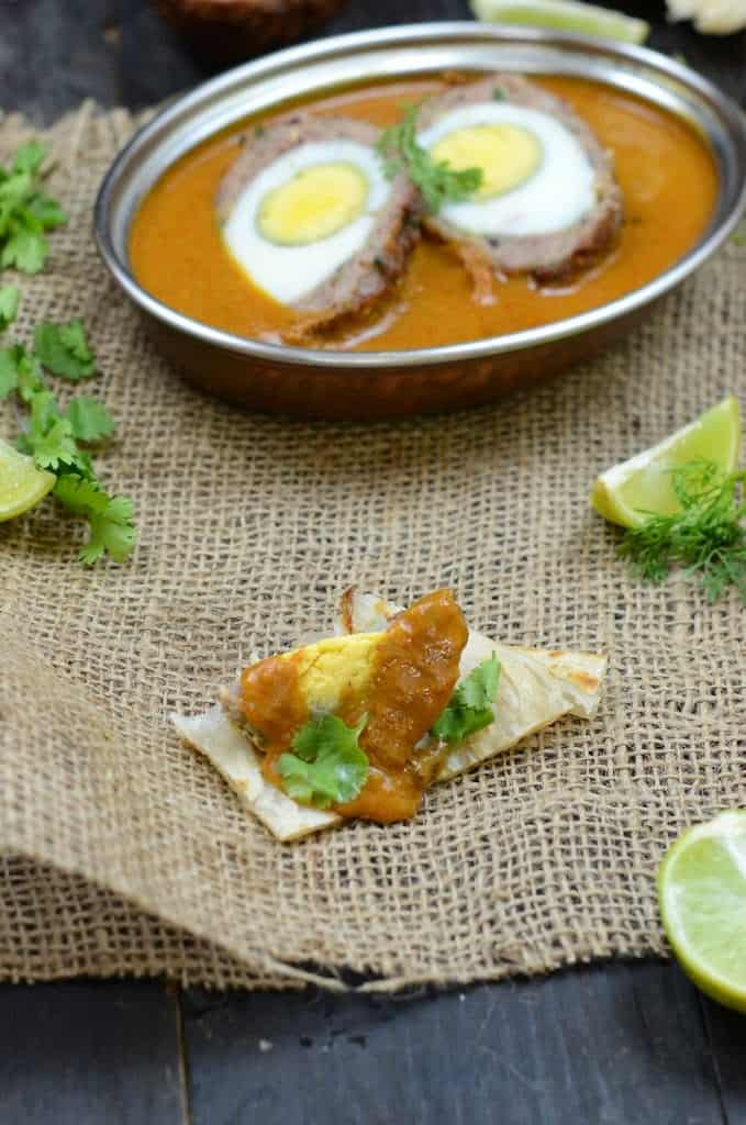 Nargisi Kofta is a traditional Mughlai dish where boiled eggs are wrapped with flavored mince meat and deep fried and then simmered in a rich gravy.