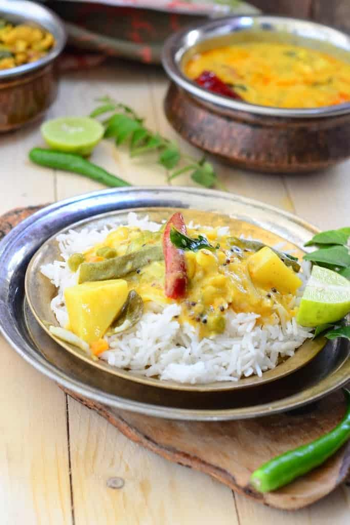 Vegetable Kadhi is a popular Indian curry made with Chickpea flour and sour yogurt. it is best enjoyed with steamed rice. Here is how to make it.