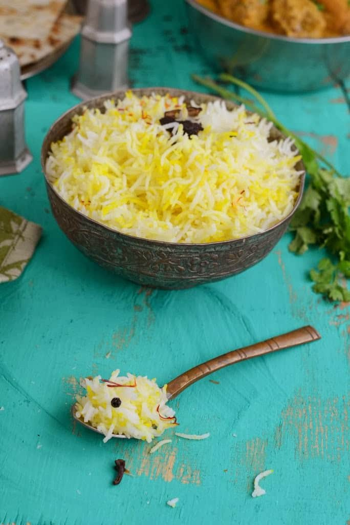 Zaffrani Pilaf or Pulao is a mildly flavored saffron rice that is the perfect foil to rich curries.