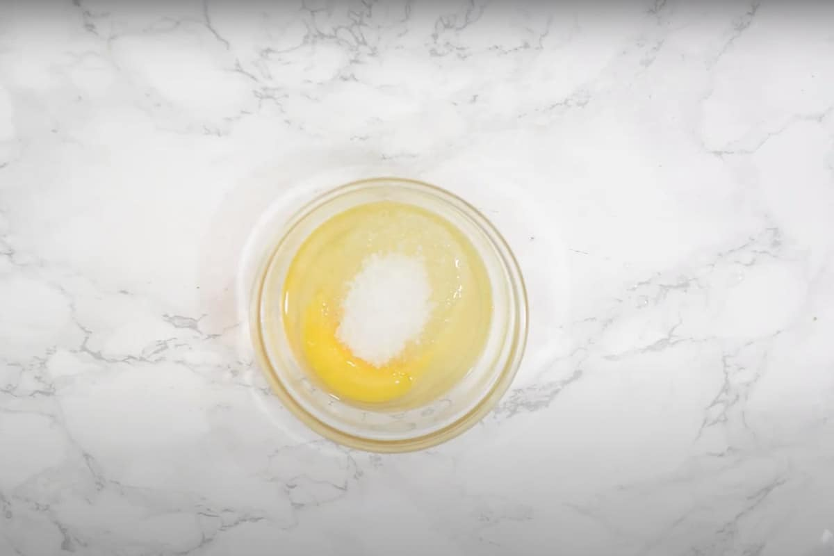 Eggs, sugar and melted butter mixed in another bowl.