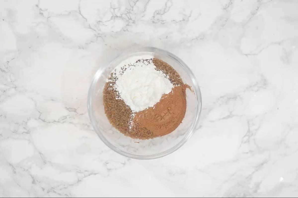Cinnamon powder, brown sugar and cornflour mixed in a bowl.