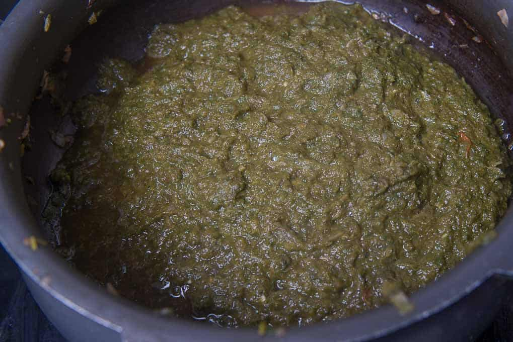 Coarsely ground sarson ka saag in a cooker