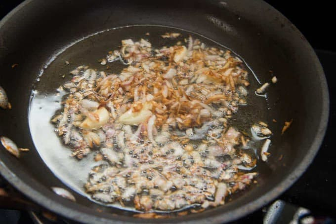 Onions and garlic browned in ghee in the pan