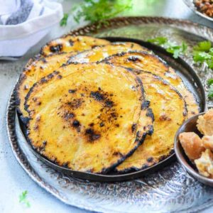 Makki ki Roti is a traditional Indian recipe made with corn meal. It is very popular bread in Punjab during winters and is usually paired with sarson ka saag. Here is a step by step recipe with some fabulous tricks to make the best makki ki roti.
