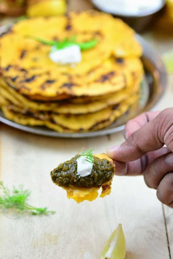 Makki ki roti or maize flour flatbread is a traditional Indian recipe made with corn meal and is usually eaten with Sarson ka saag and a piece of jaggery.