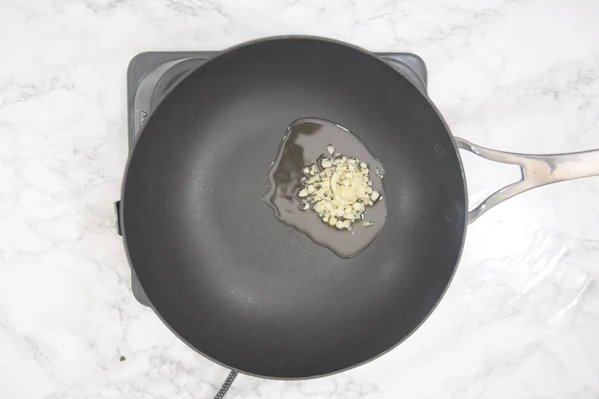 Garlic added in the wok.