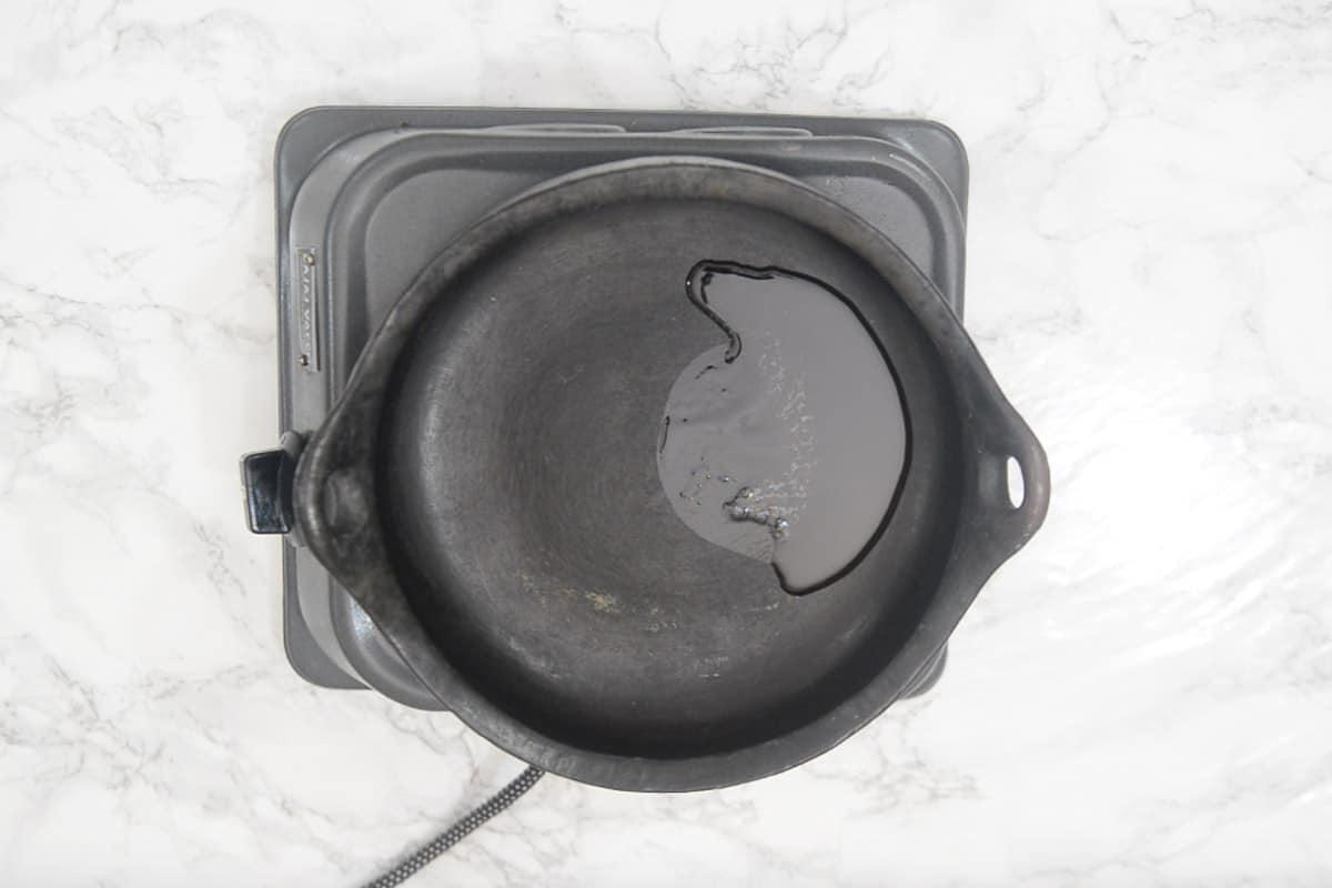 Sesame oil heating in a pan.