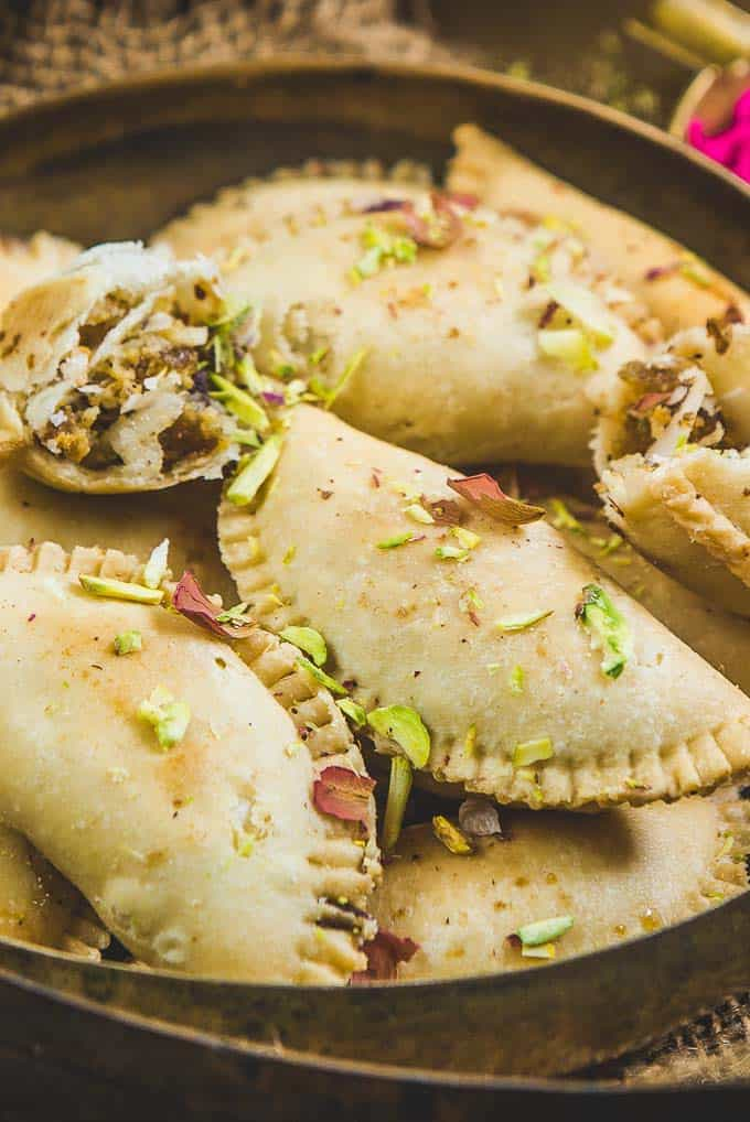 close up view of gujiya served in a plate