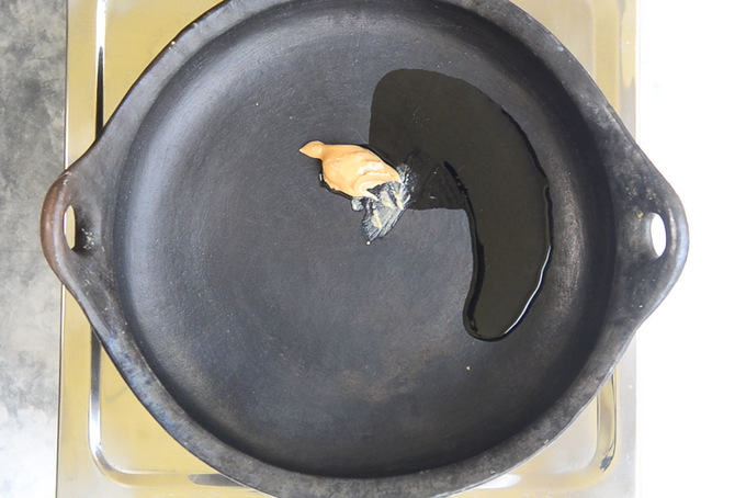 Peanut Butter and Sesame oil heating in a pan.