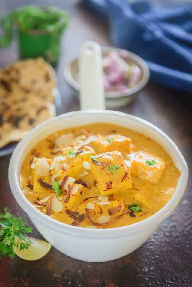 Shahi paneer served in a serving bowl.