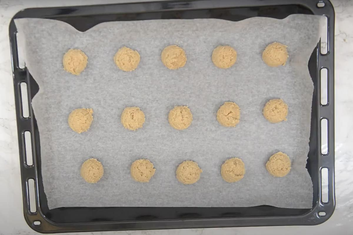 Dough scooped on the tray.