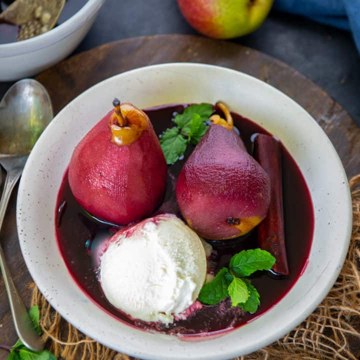 These easy red wine poached pears are probably one of the easiest and the most elegant dessert any one can make. Serve it for your weekend brunch or as a dessert for house parties, this one will surely mark its place!