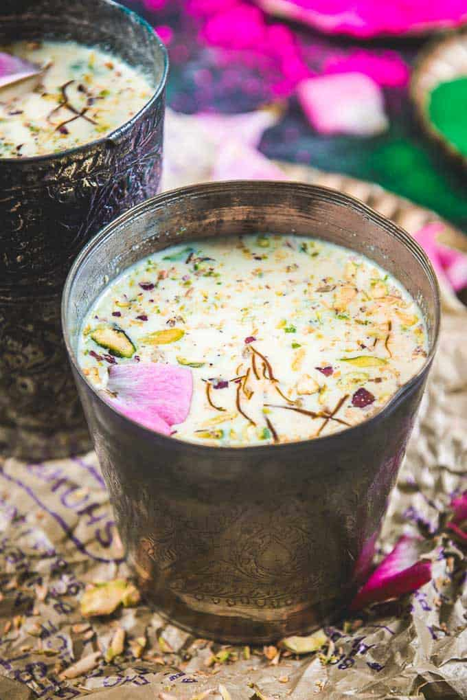 Close up view of thandai served in metal glass