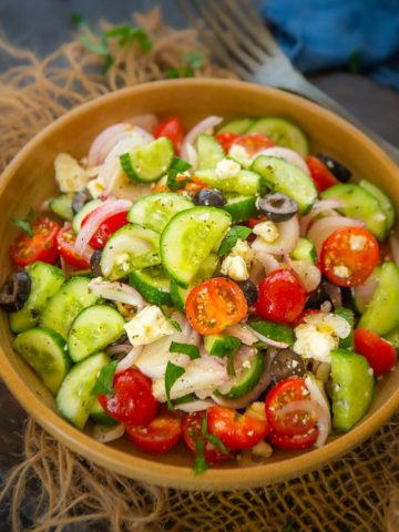 This Traditional Greek Salad Recipe (Horiatiki) is as authentic as it can get. Sourced directly from a Greek Chef, I am sharing everything that you should know about this Greek Village Salad.