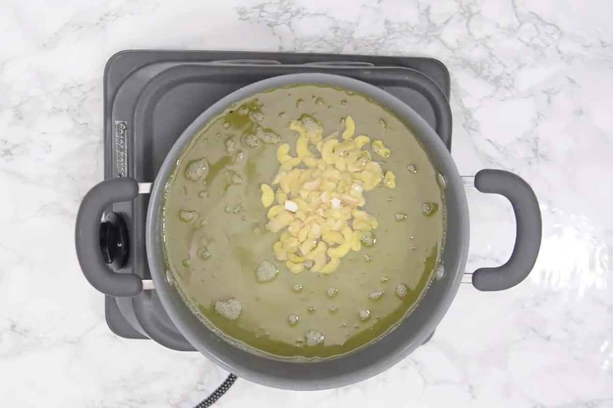 Cashew nuts frying in oil.