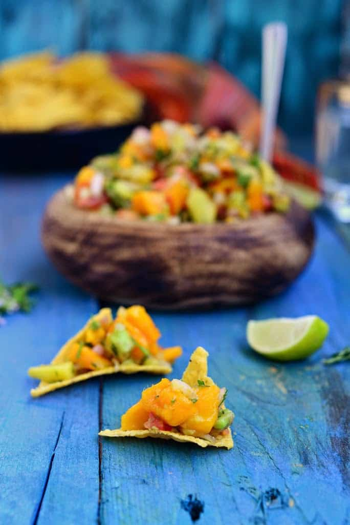 Mango Avocado Salsa is a delicious snack made using ripe and juice mangoes and avocado. Enjoy it with some crackers or pita bread.