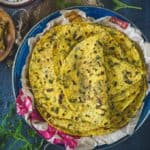 Methi Thepla is a very popular Gujarati dish made with whole wheat flour, chickpea flour, spices and fresh fenugreek leaves.