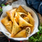 Chicken Samosa is a deep-fried snack where a crispy patty is filled with the flavourful chicken masala. Here is how to make it.