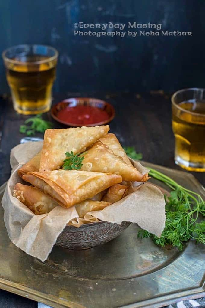Flaky and crispy outer crust filled with a cheesy chicken filling makes this Chicken Cheese Samosa are a perfect choice for appetizers or snacks.