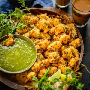 Crunchy from outside and soft from inside, these Moong Dal Pakoda or moongode are Indian lentil fritters which can be served with green chutney. Here is how to make Moong Dal Pakoda recipe.