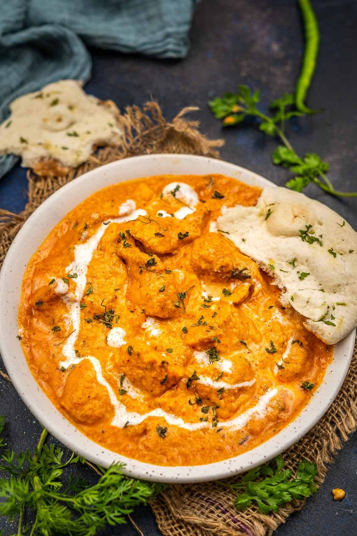 Butter chicken served in a bowl.