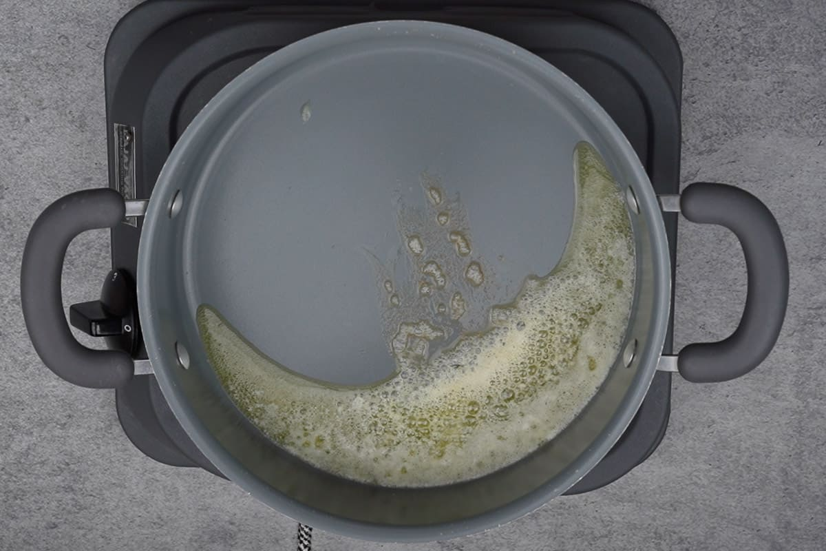 Butter heating in a pan.