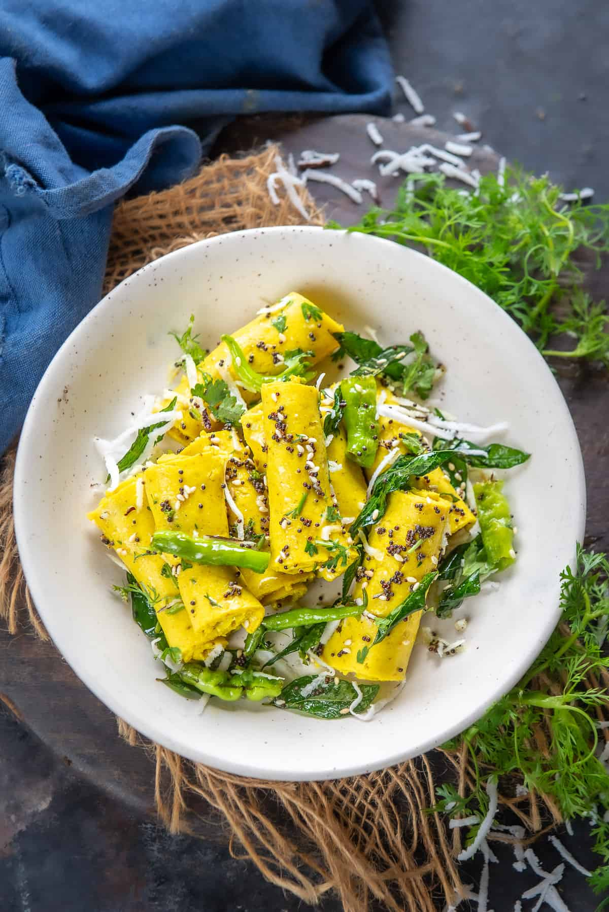 Khandvi served on a plate.
