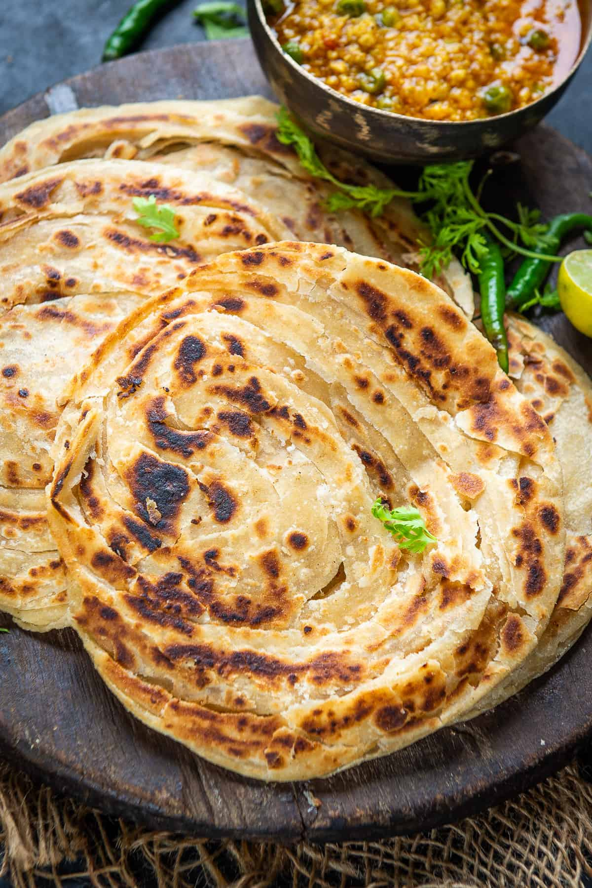 lachha Paratha stacked on a plate.