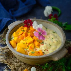 Mango Raita is a delicious curd based accompaniment which goes very well with any meals. Ripe mango and mint makes this raita very special.