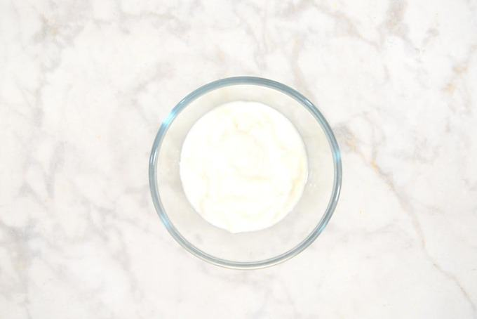 Curd whisked in a bowl.