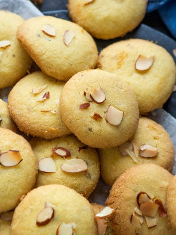 Nankhatai is a delicious crunchy Indian shortbread cookie made using ghee and flour. Make this yummy eggless bakery-style cookie at home using my simple recipe.