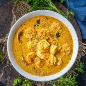 Prawn Coconut Curry is a delicious Indian shrimp curry where coconut milk is the star ingredient along with the shrimps. Here is how to make prawn curry with coconut milk.