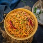 Schezwan Fried Rice is an easy and delicious rice stir fry dish where cooked rice is tossed with spicy sauces and veggies. Here is how to make Schezwan fried rice recipe.