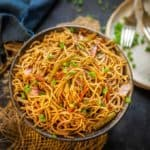 Hakka Noodles are easy and delicious wok tossed noodles. Thin noodles are tossed with veggies and sauces on high flame to make this Chinese delicacy. Here is how to make hakka noodles recipe.