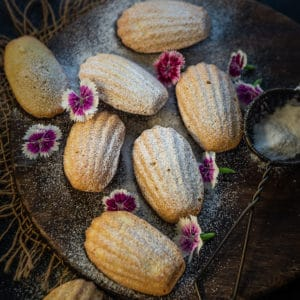 Madeleines Cookies are classic French cake like cookies which are a treat to serve for tea time. Here is how to make these at home.